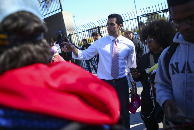 U.S. Rep. Ruben Kihuen, D-Nev., gathers with demonstrators supporting women's rights outside of the Lloyd George U.S. Courthouse in downtown Las Vegas on Saturday, Jan. 21, 2017. (Chase Stevens/La ...