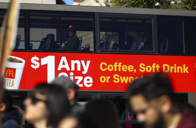 A man looks out from a bus as demonstrators march for women's rights along Las Vegas Boulevard in downtown Las Vegas on Saturday, Jan. 21, 2017. (Chase Stevens/Las Vegas Review-Journal) @csstevens ...