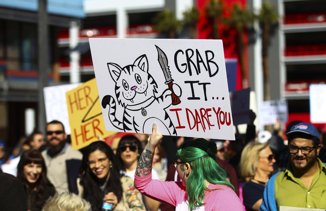 Demonstrators march for women's rights along Las Vegas Boulevard in downtown Las Vegas on Saturday, Jan. 21, 2017. (Chase Stevens/Las Vegas Review-Journal) @csstevensphoto