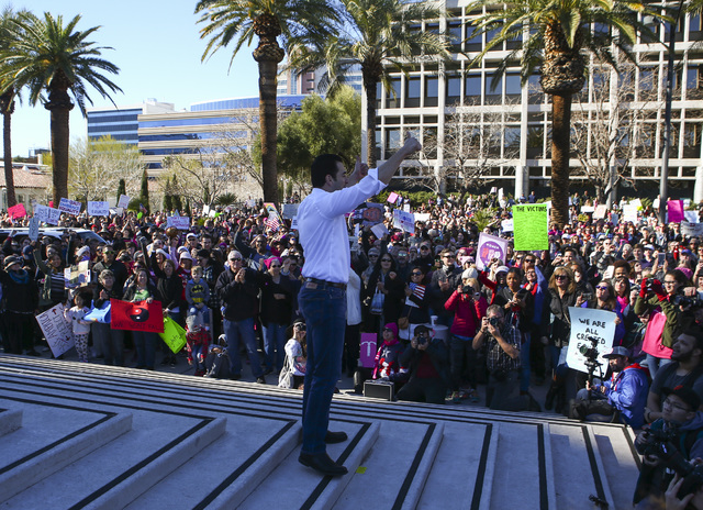 U.S. Rep. Ruben Kihuen, D-Nev., speaks as supporters of women's rights gather outside of the Lloyd George U.S. Courthouse in downtown Las Vegas on Saturday, Jan. 21, 2017. (Chase Stevens/Las Vegas ...