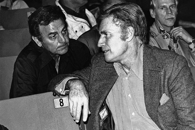 """Mike Connors, left, and Charlton Heston confer during a meeting of the Screen Actor's Guild in Los Angeles, Feb. 22, 1982. Connors, who played a private eye on the TV series """"Mannix,"""" has died at  ..."""
