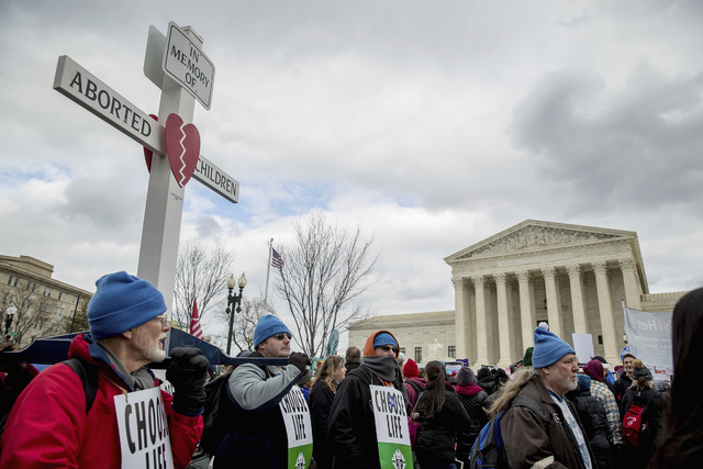 Pro-life activists converge in front of the Supreme Court in Washington, Friday, Jan. 27, 2017, during the annual March for Life. Thousands of anti-abortion demonstrators gathered in Washington fo ...