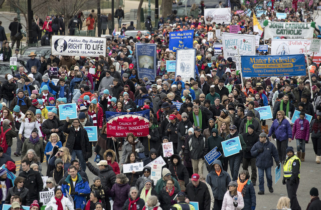 Anti-abortion demonstrators arrive on Capitol Hill in Washington, Friday, Jan. 27, 2017, during the March for Life. The march, held each year in the Washington marks the anniversary of the 1973 Su ...