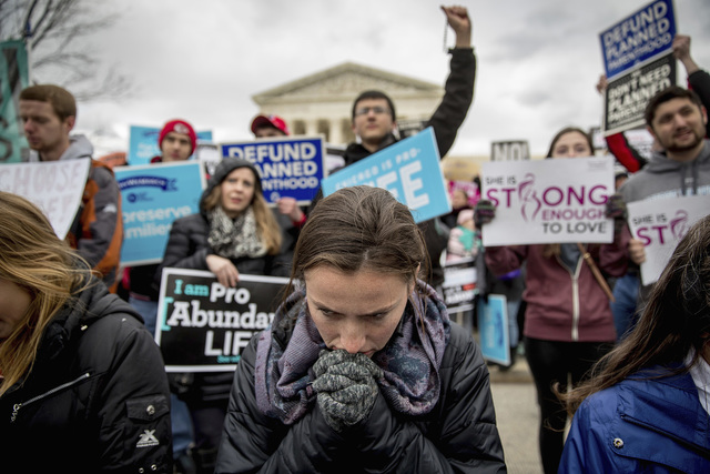 Anti-abortion activists converge in front of the Supreme Court in Washington, Friday, Jan. 27, 2017, during the annual March for Life. Thousands of anti-abortion demonstrators gathered in Washingt ...