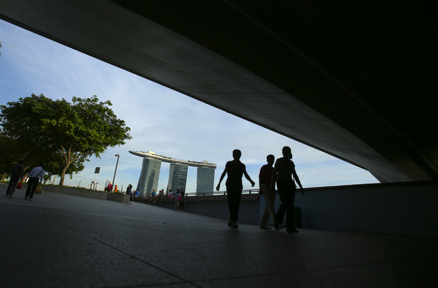 People walk near the Marina Bay Sands Singapore Tuesday, Nov. 27, 2012. The 2,561-room hotel opened in 2010 is located on reclaimed land in Marina Bay. (Jeff Scheid/Las Vegas Review-Journal)