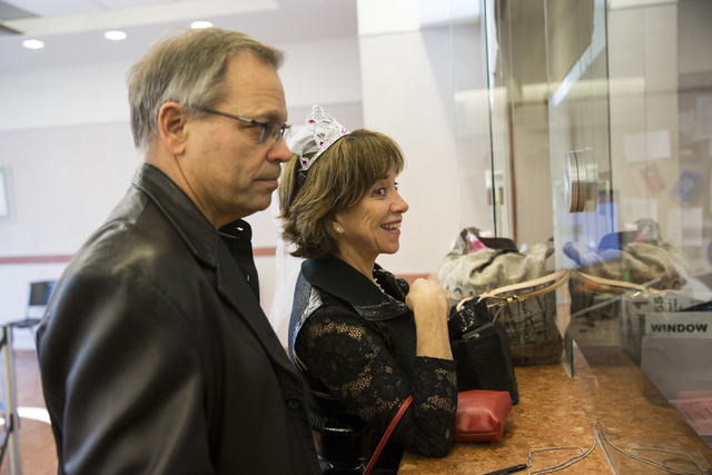 Karl Bode, left, and Nancy Fromm of Phoenix complete their marriage license at the Clark County Marriage License Bureau on Friday, Jan. 13, 2017, in Las Vegas. Erik Verduzco/Las Vegas Review-Journ ...