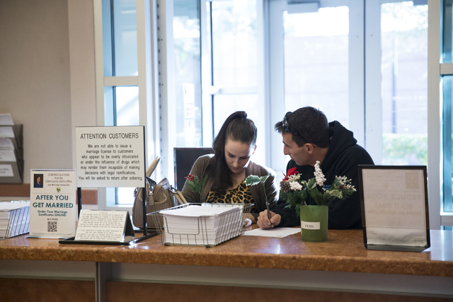 Claire Cotton, left, and James Johnson of Arizona complete their marriage license application at the Clark County Marriage License Bureau on Friday, Jan. 13, 2017, in Las Vegas. Erik Verduzco/Las  ...