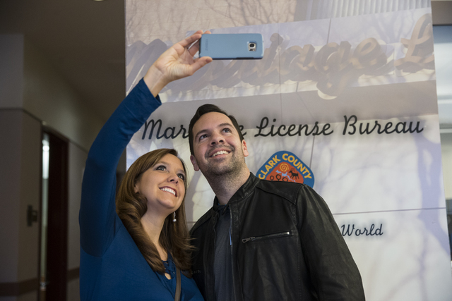 Brittney McDaniel, left, and Terry Sleister of Georgia take a photo after completing their marriage license at the Clark County Marriage License Bureau on Friday, Jan. 13, 2017, in Las Vegas. Erik ...