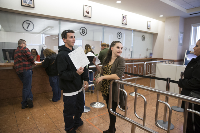 James Johnson, left, with Claire Cotton of Arizona wait in line to submit their marriage license application at the Clark County Marriage License Bureau on Friday, Jan. 13, 2017, in Las Vegas. Eri ...