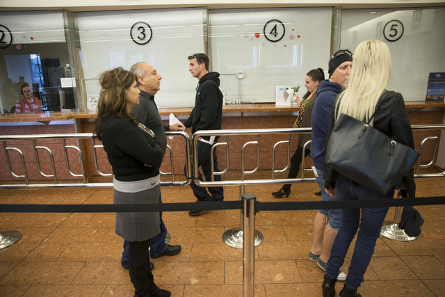 James Johnson, left, with Claire Cotton of Arizona walk to a window to submit their marriage license application at the Clark County Marriage License Bureau on Friday, Jan. 13, 2017, in Las Vegas. ...