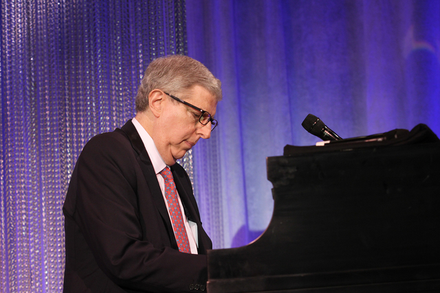 Composer Marvin Hamlisch performs at the Cedars-Sinai Board of Governors Gala at The Beverly Hilton Hotel in Beverly Hills, Calif., Nov. 8, 2011. (Cedars-Sinai Medical Center, Alex J. Berliner/AP)