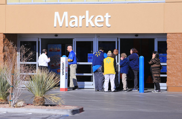 Wal-Mart employees stand outside of the store on East Serene Avenue after a grease fire at the McDonald's inside closed down the store on Saturday, Jan. 28, 2017, in Las Vegas. Brett Le Blanc/Las  ...