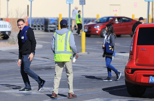 Wal-Mart employees talk to each other outside of the store on East Serene Avenue after a grease fire at the McDonald's inside closed down the store on Saturday, Jan. 28, 2017, in Las Vegas. Brett  ...