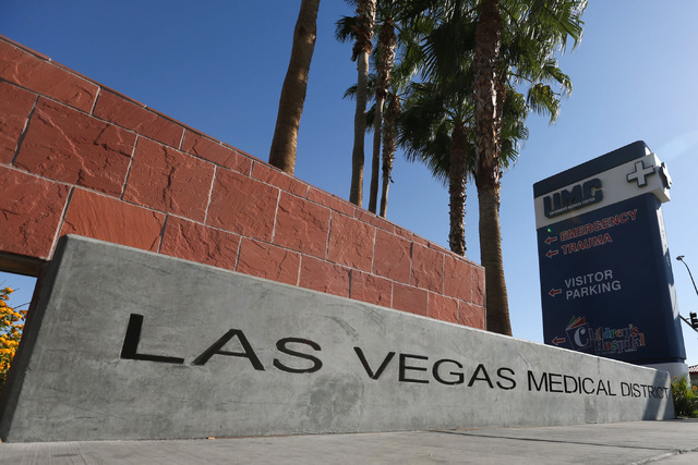 A sign advertising the Las Vegas Medical District sits under a University Medical Center guidepost in Las Vegas on Friday, Sept. 2, 2016. (Brett Le Blanc/Las Vegas Review-Journal) Follow @bleblanc ...