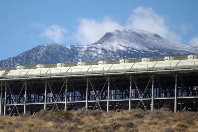 Mount Rose looms behind the Ormat Steamboat Geothermal Complex near the Mount Rose Highway in this undated file photo from the Reno Gazette-Journal. A proposed state bill would keep prices of rene ...