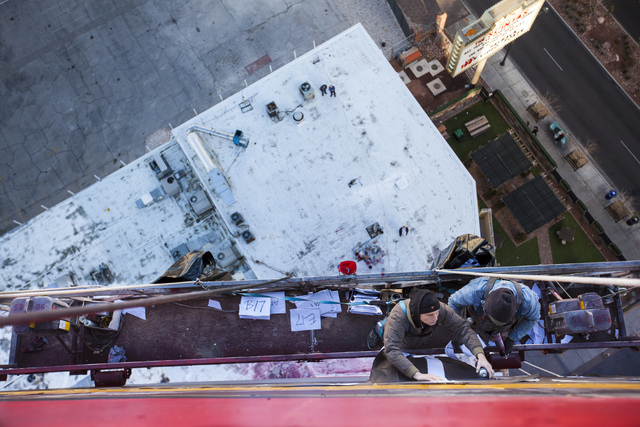 Contemporary street artist Shepard Fairey, left, and an assistant work on a mural on the side of The Plaza hotel-casino in downtown Las Vegas on Thursday, Jan. 26, 2017. (Miranda Alam/Las Vegas Re ...