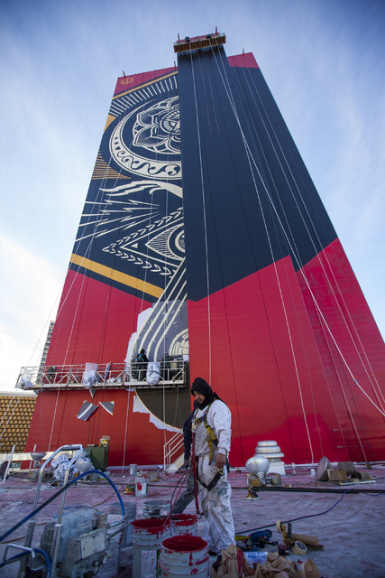 A mural by contemporary street artist Shepard Fairey is shown in progress on the side of The Plaza hotel-casino in downtown Las Vegas on Wednesday, Jan. 25, 2017. (Miranda Alam/Las Vegas Review-Jo ...