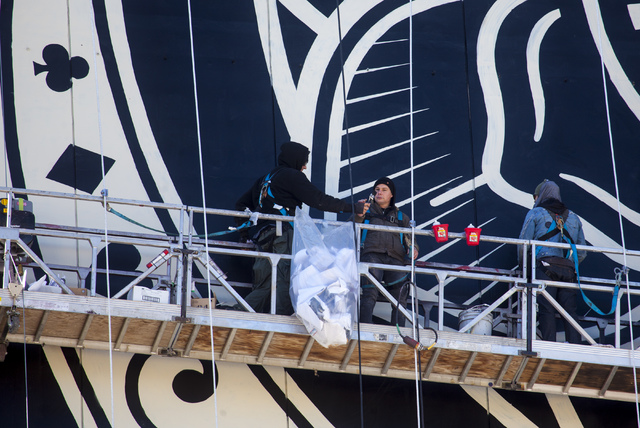 Contemporary street artist Shepard Fairey, center, works with a team on a mural on the side of The Plaza hotel-casino in downtown Las Vegas on Wednesday, Jan. 25, 2017. (Miranda Alam/Las Vegas Rev ...
