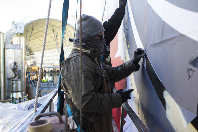 Members of Shepard Fairey's team work on a mural on the side of The Plaza hotel-casino in downtown Las Vegas on Thursday, Jan. 26, 2017. (Miranda Alam/Las Vegas Review-Journal) @miranda_alam