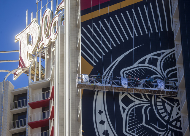Street artist shepard fairey is creating a mural on the for Contemporary resort mural