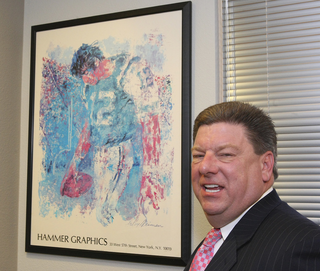 Mike Shustek, chairman of the Vestin Group, shows off a print of football player Joe Namath who, he says, worked at Vestin for a short time, in Las Vegas on Monday, June 1, 2009. Gary Thompson/Las ...