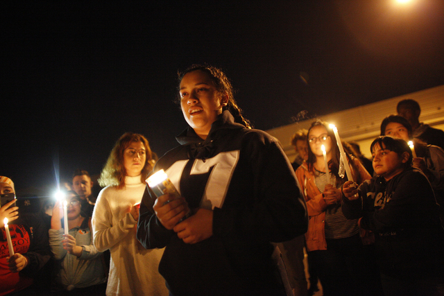 Mara Moya, 17, talks to the crowd that gathered for a vigil in honor of Richard Nelson on Sunday, Jan. 15, 2017, at Chaparral High School in Las Vegas. Nelson was shot and killed Saturday night in ...