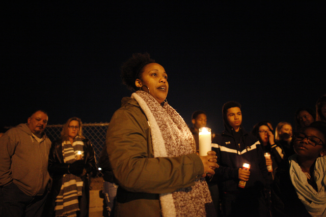 Abel Porter talks to the crowd that gathered for a vigil in honor of Richard Nelson on Sunday, Jan. 15, 2017, at Chaparral High School in Las Vegas. Nelson was shot and killed Saturday night in fr ...
