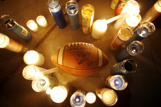A football that people passed around and signed at a vigil in honor of Richard Nelson on Sunday, Jan. 15, 2017, at Chaparral High School in Las Vegas. Nelson was shot and killed Saturday night in  ...
