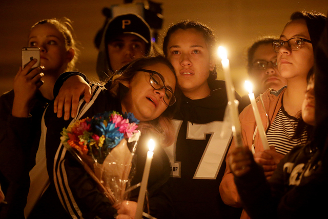 Bianey Castillo is consoled by Mara Moya, 17, at a vigil to honor Richard Nelson on Sunday, Jan. 15, 2017, at Chaparral High School in Las Vegas. Nelson was shot and killed Saturday night in front ...