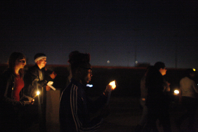 Tyray Collins, 16, carries a candle at a vigil in honor of Richard Nelson on Sunday, Jan. 15, 2017, at Chaparral High School in Las Vegas. Nelson was shot and killed Saturday night in front of his ...