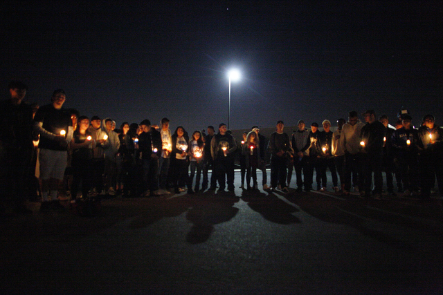 A crowd gathers at a vigil in honor of Richard Nelson on Sunday, Jan. 15, 2017, at Chaparral High School in Las Vegas. Nelson was shot and killed Saturday night in front of his home. (Rachel Aston ...