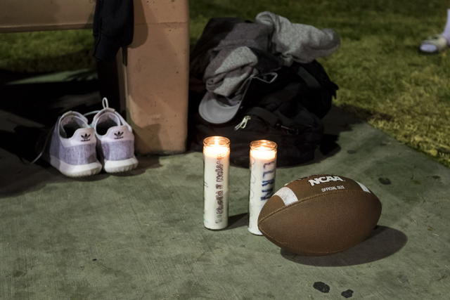 Candles are lit in honor of former Chaparral High School football star Richard Nelson at Winchester Park in Las Vegas on Monday, Jan. 16, 2017. The Missouri State University freshman and football  ...