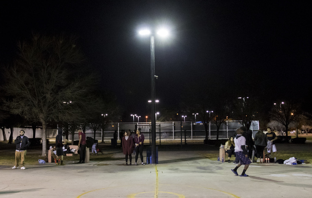 People play basketball in honor of former Chaparral High School football star Richard Nelson at Winchester Park in Las Vegas on Monday, Jan. 16, 2017. The Missouri State University freshman and fo ...