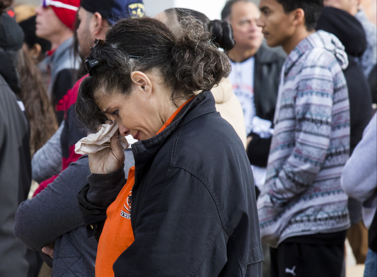 An attendee wipes away tears during a memorial service for Richard Nelson at Chaparral High School in Las Vegas on Thursday, Jan. 19, 2017. (Miranda Alam/Las Vegas Review-Journal) @miranda_alam