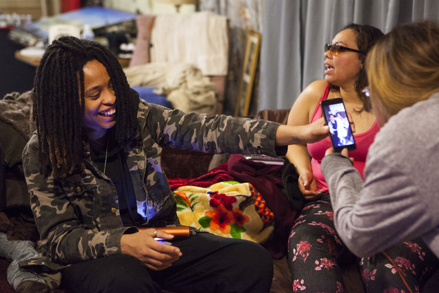 Oniesha Coleman and her mother Roxanne Bruce laugh at a photo of Richard Nelson with his girlfriend Christina Martinez at the family home in Las Vegas on Tuesday, Jan. 17, 2017. The Missouri State ...