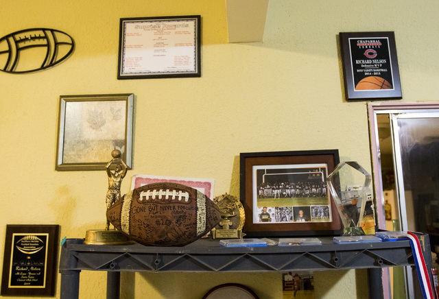 Awards won by Richard Nelson are displayed in his mother's home in Las Vegas on Tuesday, Jan. 17, 2017. The Missouri State University freshman and football player was fatally shot late Saturday tr ...