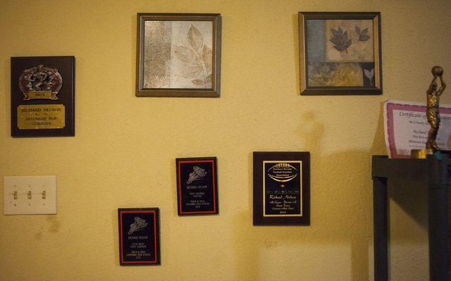 Awards won by Richard Nelson hang on the wall in his mother's home in Las Vegas on Tuesday, Jan. 17, 2017. The Missouri State University freshman and football player was fatally shot late Saturday ...