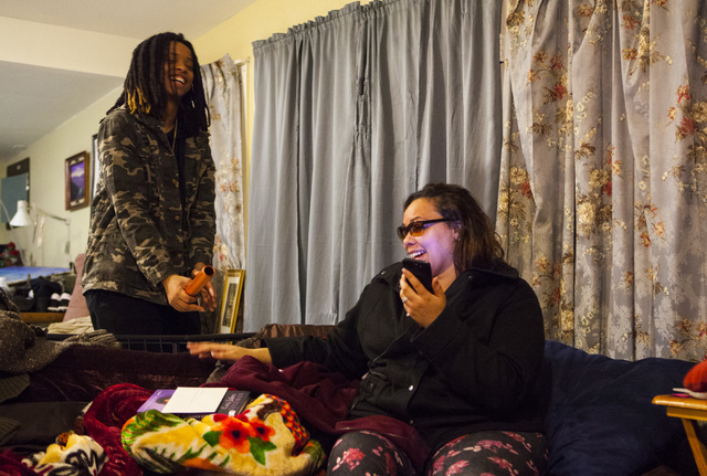 Oniesha Coleman and her mother Roxanne Bruce laugh at a photo of Richard Nelson in their home in Las Vegas on Tuesday, Jan. 17, 2017. The Missouri State University freshman and football player was ...