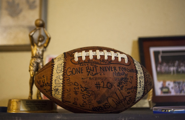 The football that was passed around and signed at Richard Nelson's vigil sits on display in his mother's home in Las Vegas on Tuesday, Jan. 17, 2017. The Missouri State University freshman and foo ...