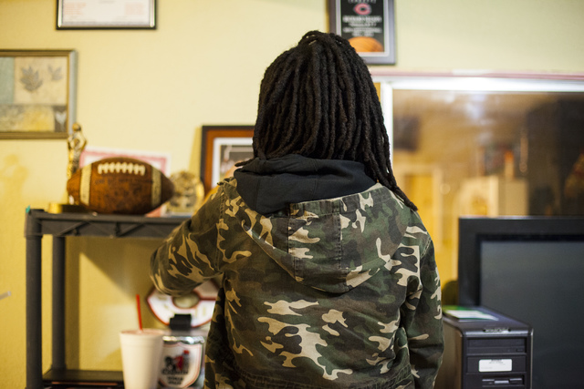 Oniesha Coleman looks over the awards her brother won in her home in Las Vegas on Tuesday, Jan. 17, 2017. The Missouri State University freshman and football player was fatally shot late Saturday  ...