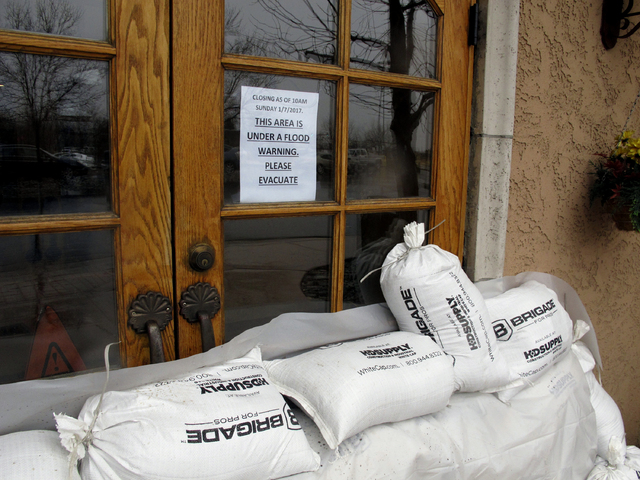 Sandbags line the doors of the Alamo truck stop and casino along U.S. Interstate 80 due to flooding Sunday, Jan. 8, 2017 in Sparks, Nev. More than 1,000 homes have been evacuated due to overflowin ...