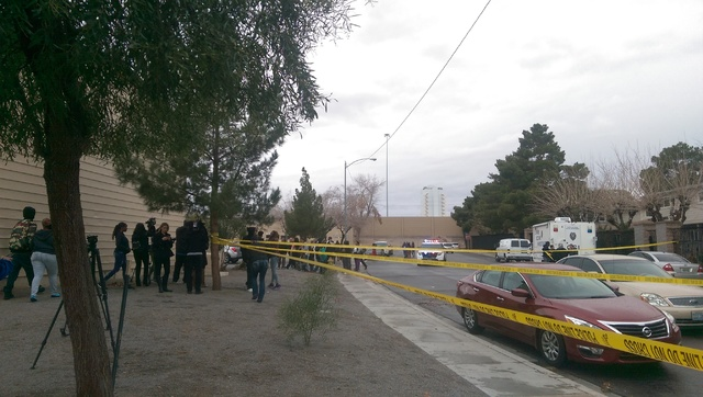 A fight broke out at the scene of homicide in North Las Vegas after a woman who said she was the victim's mother demanded to see her daughter's body, Friday, Jan. 13, 2017. (Brooke Wanser/Las Vega ...