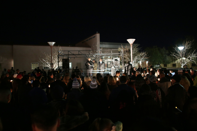 Different religious speakers address the crowd at a candlelight vigil to honor North Las Vegas Police Detective Chad Parque in front of the North Las Vegas Justice Court on Sunday, Jan. 8, 2017, i ...