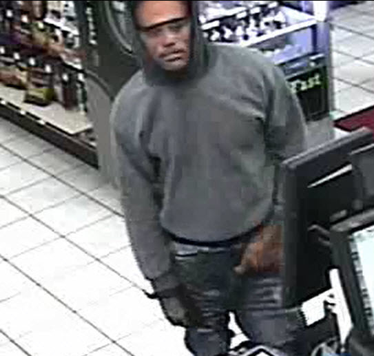 North Las Vegas police are trying to identify two men suspected of robbing a business on the 4200 block of East Craig Road Sunday. (North Las Vegas Police Department)