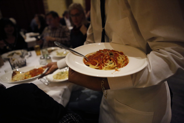A server places an order of spaghetti on a guests table at Nora's Italian Cuisine on Friday, Jan. 6, 2017, in Las Vegas. (Christian K. Lee/Las Vegas Review-Journal) @chrisklee_jpeg