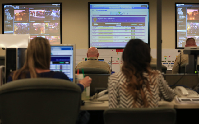 Workers from multiple agencies in Nevada staff the New Year's Eve command center at the Metropolitan Police Department headquarters on Saturday, Dec. 31, 2016. (Brett Le Blanc/Las Vegas Review-Jou ...
