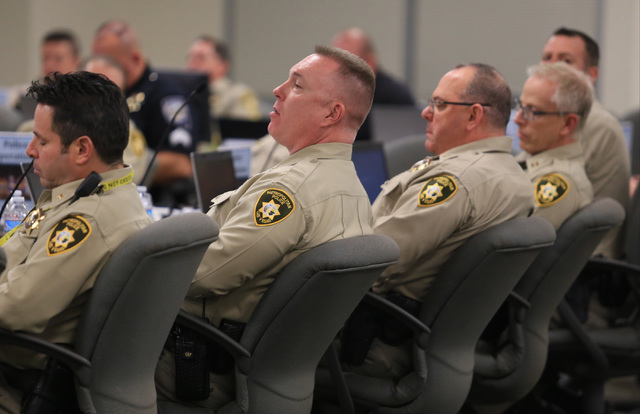 Las Vegas police officers, along with workers from other agencies in Nevada, staff the New Year's Eve command center at the Metropolitan Police Department headquarters on Saturday, Dec. 31, 2016.  ...
