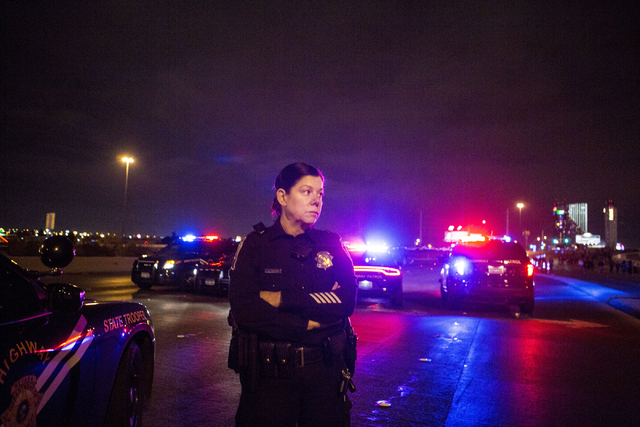 Nevada Highway Patrol trooper Angie Wolff patrols the Flamingo Road overpass while pedestrians walk toward the Las Vegas Strip on New Year's Eve, Dec. 31, 2016. (Elizabeth Brumley/Las Vegas Review ...