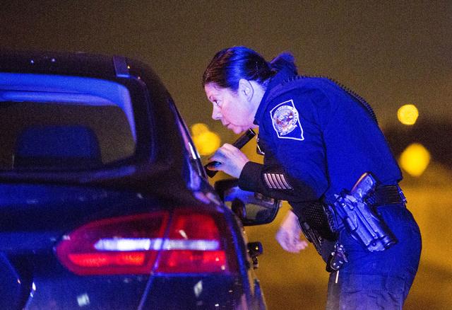 Nevada Highway Patrol trooper Angie Wolff speaks to a driver for speeding in downtown Las Vegas on Dec. 31, 2016. (Elizabeth Brumley/Las Vegas Review-Journal) @EliPagePhoto