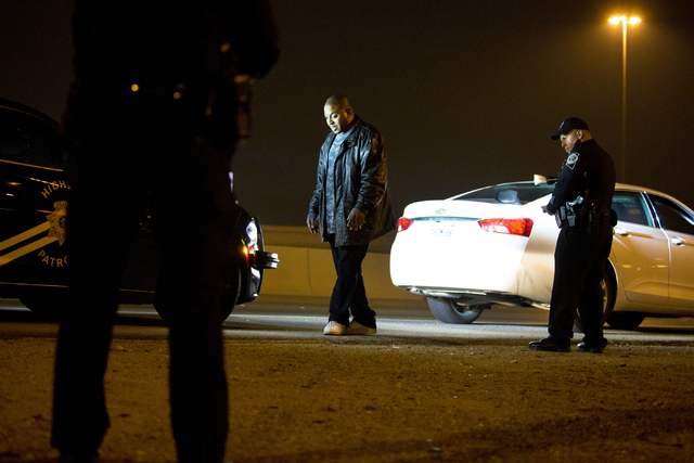 Nevada Highway Patrol trooper Ervin Raab, right, conducts a field sobriety test for a DUI suspect near the Spaghetti Bowl on Dec. 31, 2016. (Elizabeth Brumley/Las Vegas Review-Journal) @EliPagePhoto